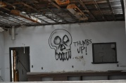 A message sprayed on the back wall of the abandoned gas station