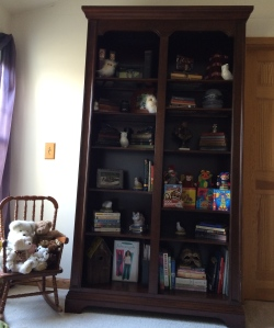 Full view of bookcase with side bear chair